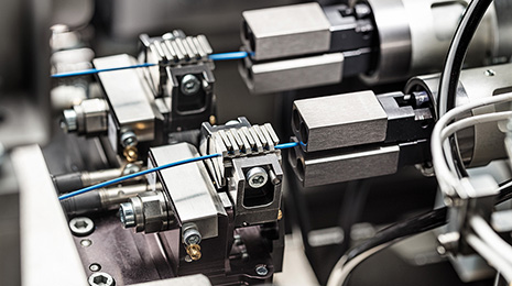 Close up of Komax wiring machine parts in use.